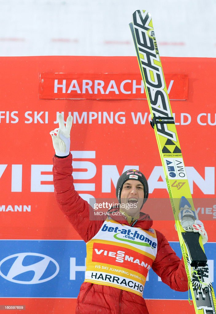 Gregor Schlierenzauer of Austria celebrates on the podium after the second competition of the Ski Flying event of the FIS Ski Jumping World Cup in Harrachov on February 03, 2013.Gregor Schlierenzauer of Austria won this event ahead Jan Matura of the Czech Repuplic (2nd) and Jurij Tepes of Slovenia (3rd).