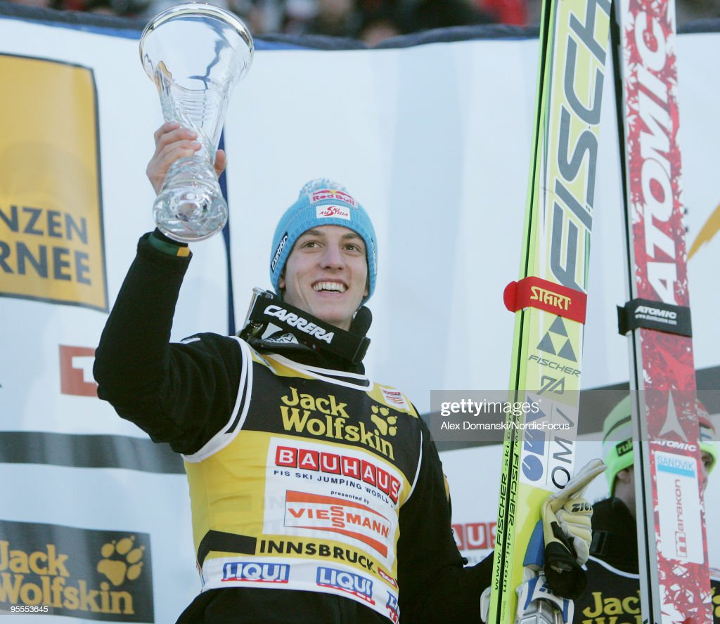 Gregor Schlierenzauer of Austria celebrates on the podium after winning the FIS Ski Jumping World Cup event of the 58th Four Hills ski jumping tournament on January 3, 2010 in Innsbruck, Austria.