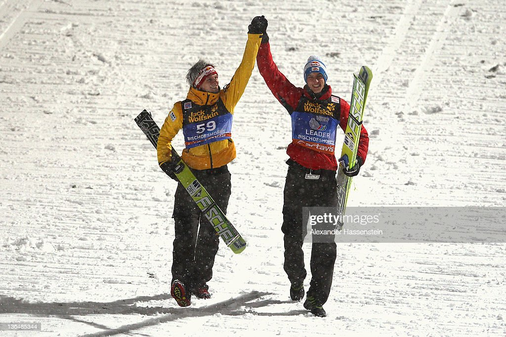 <a gi-track='captionPersonalityLinkClicked' href=/galleries/search?phrase=Gregor+Schlierenzauer&family=editorial&specificpeople=2963942 ng-click='$event.stopPropagation()'>Gregor Schlierenzauer</a> (R) of Austria celebrates winning the 60th Four Hills ski jumping tournament with his team mate <a gi-track='captionPersonalityLinkClicked' href=/galleries/search?phrase=Thomas+Morgenstern&family=editorial&specificpeople=221616 ng-click='$event.stopPropagation()'>Thomas Morgenstern</a> after the final round of the FIS Ski Jumping World Cup event at Paul-Ausserleitner-Schanze on January 6, 2012 in Bischofshofen, Austria.