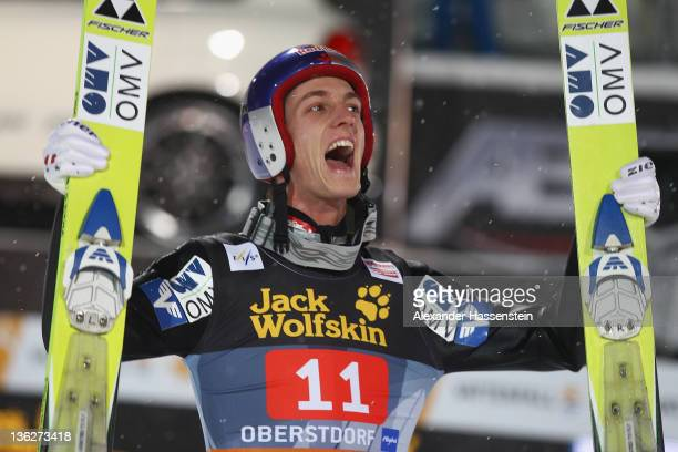 Gregor Schlierenzauer of Austria celebrates winning the FIS Ski Jumping World Cup event of the 60th Four Hills ski jumping tournament at Erdinger...