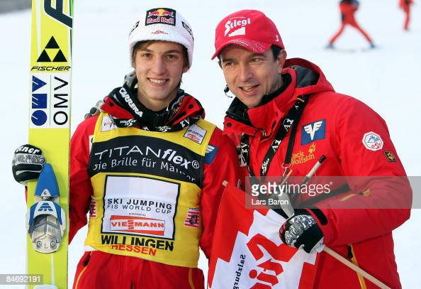 Gregor Schlierenzauer of Austria celebrates with his coach Alexander Pointner after winning the FIS Ski World Cup at the Muehlenkopfschanze on...