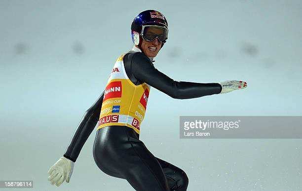 Gregor Schlierenzauer of Austria smiles after winning the qualification round for the FIS Ski Jumping World Cup event of the 61th Four Hills ski...