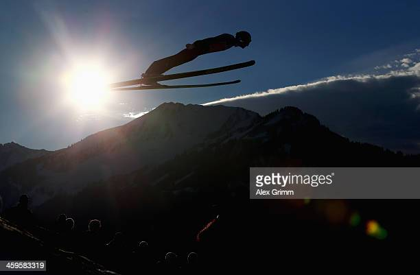 Gregor Schlierenzauer of Austria soars through the air during the training round on day 1 of the Four Hills Tournament Ski Jumping event at...