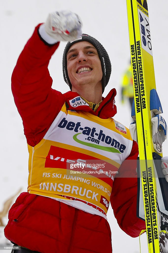 <a gi-track='captionPersonalityLinkClicked' href=/galleries/search?phrase=Gregor+Schlierenzauer&family=editorial&specificpeople=2963942 ng-click='$event.stopPropagation()'>Gregor Schlierenzauer</a> of Austria takes 1st place during the FIS Ski Jumping World Cup Vierschanzentournee (Four Hills Tournament) on January 04, 2013 in Innsbruck, Austria.