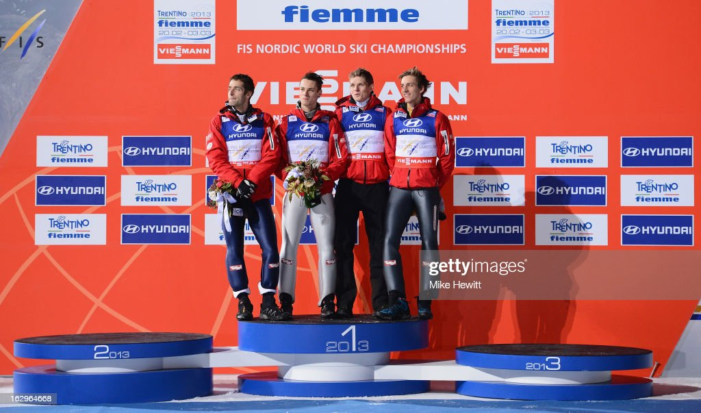 <a gi-track='captionPersonalityLinkClicked' href=/galleries/search?phrase=Gregor+Schlierenzauer&family=editorial&specificpeople=2963942 ng-click='$event.stopPropagation()'>Gregor Schlierenzauer</a>, <a gi-track='captionPersonalityLinkClicked' href=/galleries/search?phrase=Wolfgang+Loitzl&family=editorial&specificpeople=2139272 ng-click='$event.stopPropagation()'>Wolfgang Loitzl</a>, Manuel Fettner amd Thomas Morgenstern of Austria celebrate First Place on the podium following the Men's Ski Jumping Team HS134 at the FIS Nordic World Ski Championships on March 2, 2013 in Val di Fiemme, Italy.