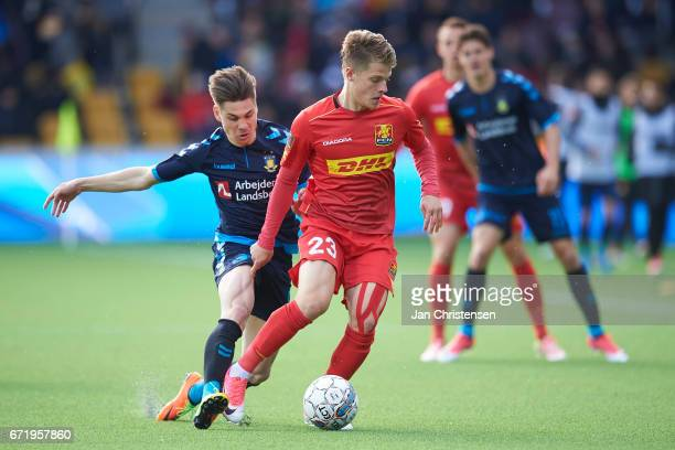 Gregor Sikosek of Brondby IF and Mathias Jensen of FC Nordsjalland compete for the ball during the Danish Alka Superliga match between FC...