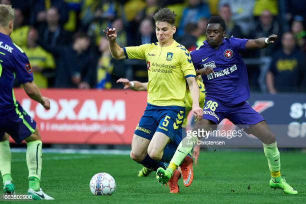 Gregor Sikosek of Brondby IF and Rilwan Hassan of FC Midtjylland compete for the ball during the Danish Alka Superliga match between Brondby IF and...