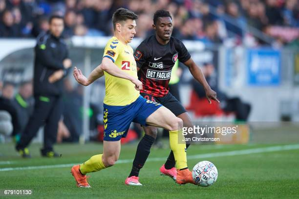 Gregor Sikosek of Brondby IF and Rilwan Hassan of FC Midtjylland compete for the ball during the Danish Cup DBU Pokalen semifinal match between FC...