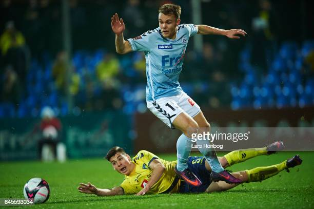 Gregor Sikosek of Brondby IF and Troels Klove of Sonderjyske compete for the ball during the Danish Alka Superliga match match between Sonderjyske...