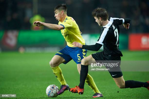 Gregor Sikosek of Brondby IF compete for the ball during the Danish Cup DBU Pokalen match between BK Marienlyst and Brondby IF at Brondby Stadion on...