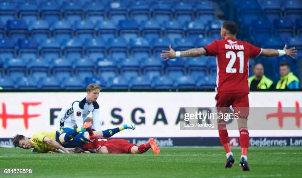 Gregor Sikosek of Brondby IF receiving a red card from referee Morten Krogh for this tackle of Lasse Fosgaard of Lyngby BK during the Danish Alka...
