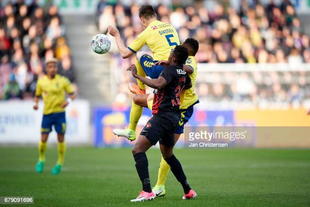 Gregor Sikosek of Brondby IF Rilwan Hassan of FC Midtjylland and Lebogang Phiri of Brondby IF compete for the ball during the Danish Cup DBU Pokalen...