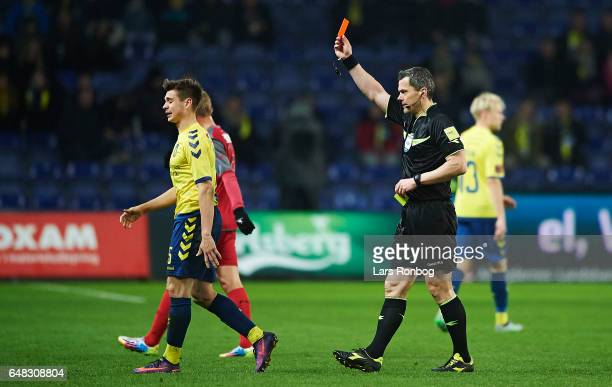 Gregor Sikosek of Brondby IF walks off the pitch after receiving a red card from referee Michael Tykgaard during the Danish Alka Superliga match...