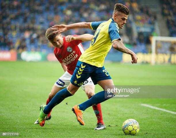 Gregor Sikosek of Silkeborg IF and Jan Kliment of Brondby IF compete for the ball during the Danish Alka Superliga match between Brondby IF and...