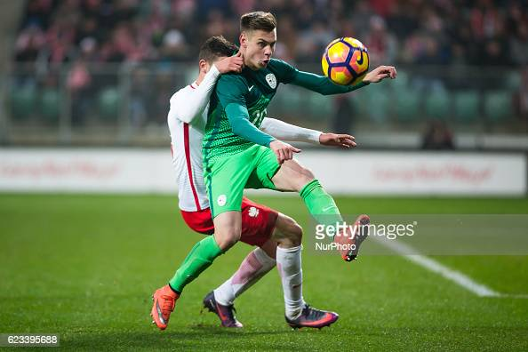 Gregor Sikosek of Slovenia vies Pawel Wszolek of Poland during the international friendly football match Poland vs Slovenia on November 14 2016 in...
