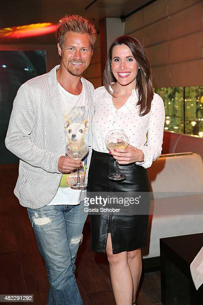 Gregor Teicher Birgit Noessing SKY during the Emporio Armani Friends event at the Armani Caffe on July 29 2015 in Munich Germany
