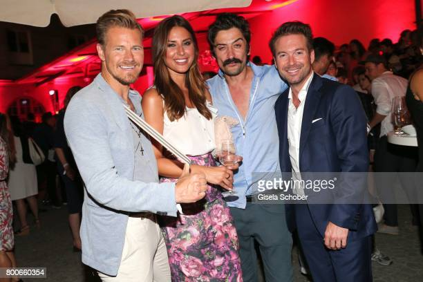 Gregor Teicher Jana Azizi Adrian Can and Sebastian Hoeffner during the 'Audi Director's cut' Party during the Munich film festival at Praterinsel on...
