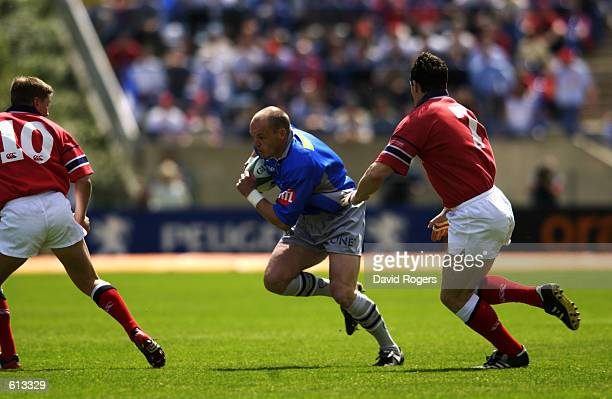 Gregor Townsend of Castres runs with the ball during the Heineken Cup semifinal match between Castres and Munster played at the Stade de la...