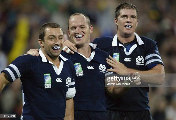 Gregor Townsend of Scotland celebrates his try during the Rugby World Cup Pool B match between Scotland and USA at Suncorp Stadium October 20 2003 in...