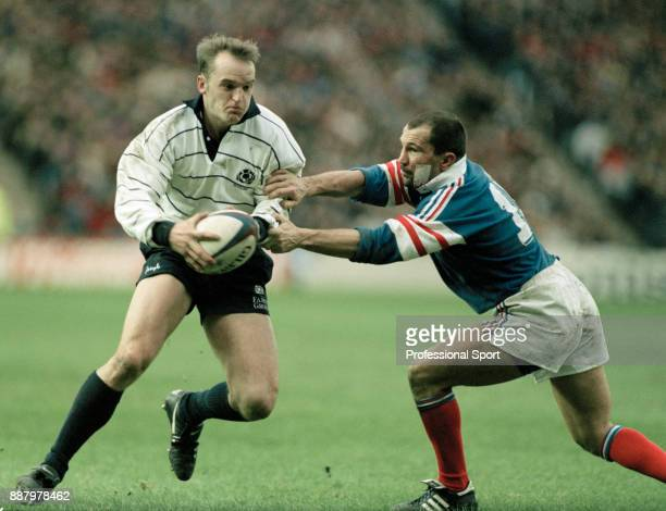 Gregor Townsend of Scotland tussles with Thierry Lacroix of France during their Five Nations rugby union match at Murrayfield in Edinburgh on 3rd...