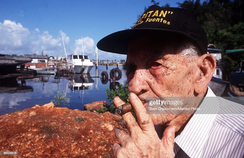 Gregorio Fuentes, former captain on Ernest Hemingway�s fishing boat Pilar, smokes a cigar at the age of 100, at his home in the little fishermen village Cojimar, on November 4, 1997, in Havana, Cuba. Many say he was the inspiration for the protagonist in Hemingway's classic The Old Man and the Sea. Fuentes, born in Lanzarote, Canary Islands, on July 11, 1897, met Hemingway in 1928 and in the 1930s the writer hired him for USD 250 a month to care for his boat. Fuentes later inherited the Pilar but donated it to the Cuban government. The Pilar is now displayed in Hemingway�s former home, now a museum. Between 1939 and 1960, the American writer and journalist Ernst Hemingway lived for many years in Cuba. It was here where he wrote his novel The Old Man and the Sea, which earned him both the Pulitzer Prize and the Nobel Prize in Literature.