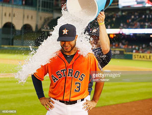 Gregorio Petit and George Springer of the Houston Astros celebrate after Petit his a solo home run during the eighth inning of their game against the...