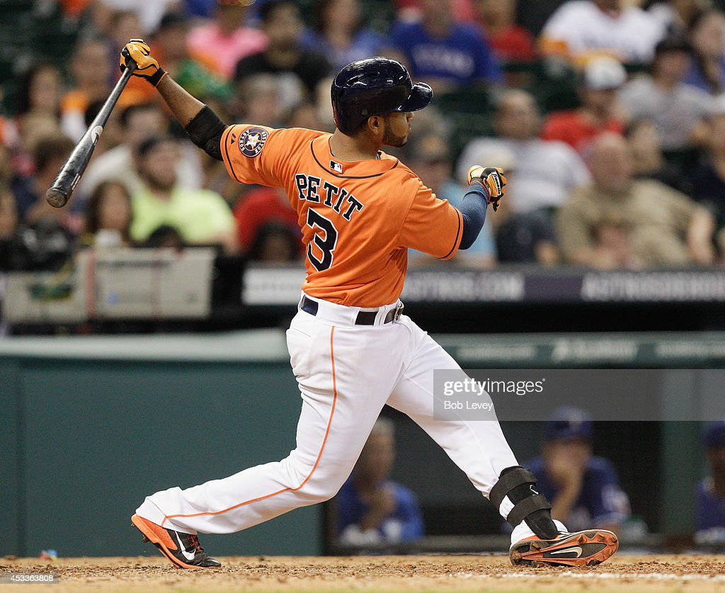 <a gi-track='captionPersonalityLinkClicked' href=/galleries/search?phrase=Gregorio+Petit&family=editorial&specificpeople=4947698 ng-click='$event.stopPropagation()'>Gregorio Petit</a> #3 of the Houston Astros doubles in the eighth inning scoring a runner against the Texas Rangers at Minute Maid Park on August 8, 2014 in Houston, Texas.