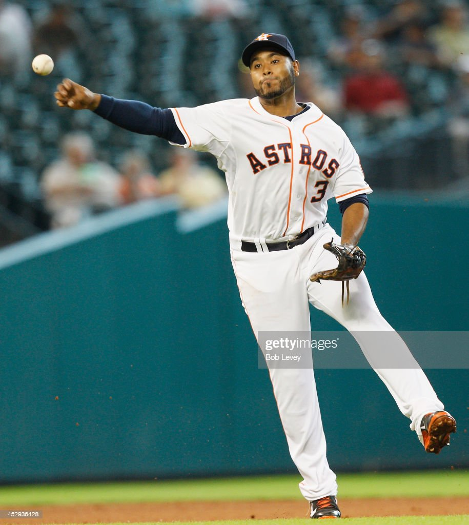 <a gi-track='captionPersonalityLinkClicked' href=/galleries/search?phrase=Gregorio+Petit&family=editorial&specificpeople=4947698 ng-click='$event.stopPropagation()'>Gregorio Petit</a> #3 of the Houston Astros throws to first base in the fourth inning against the Oakland Athletics at Minute Maid Park on July 30, 2014 in Houston, Texas.