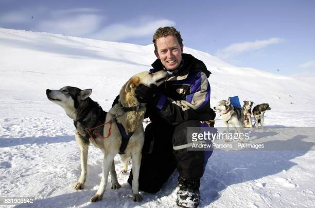 Gregory Barker MP with one of his Alaska Husky dogs Troika on top of the Scott Turner Glacier on the island of Svalbardinside the Arctic circle...