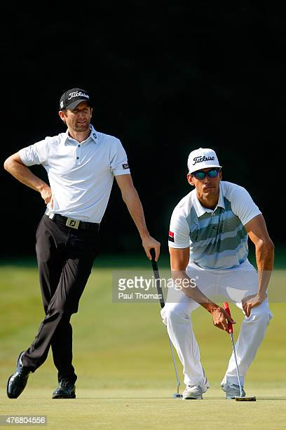 Gregory Bourdy of France and Rafa Cabrera Bello of Spain watch on during the Lyoness Open day two at the Diamond Country Club on June 12 2015 in...