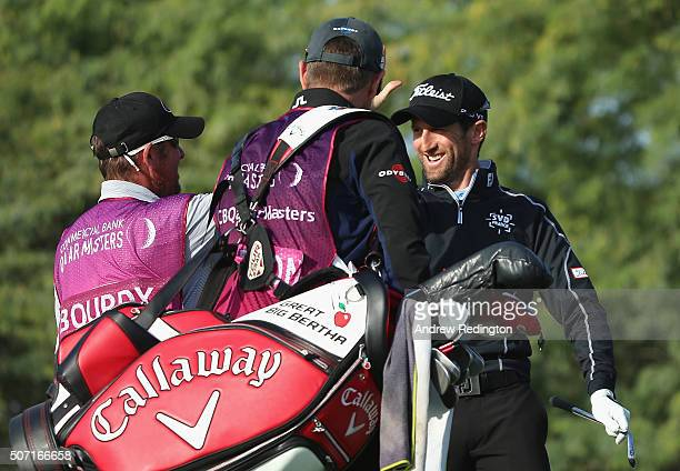 Gregory Bourdy of France celebrates with his caddie after making a holeinone on the eighth hole during the second round of the Commercial Bank Qatar...