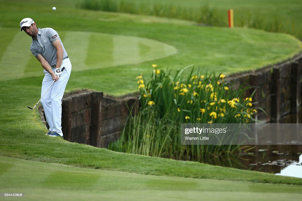 <a gi-track='captionPersonalityLinkClicked' href=/galleries/search?phrase=Gregory+Bourdy&family=editorial&specificpeople=576091 ng-click='$event.stopPropagation()'>Gregory Bourdy</a> of France chips to the 18th green during day one of the BMW PGA Championship at Wentworth on May 26, 2016 in Virginia Water, England.