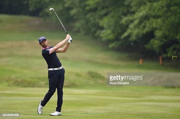 Gregory Bourdy of France hits an approach during day three of the BMW PGA Championship at Wentworth on May 28 2016 in Virginia Water England