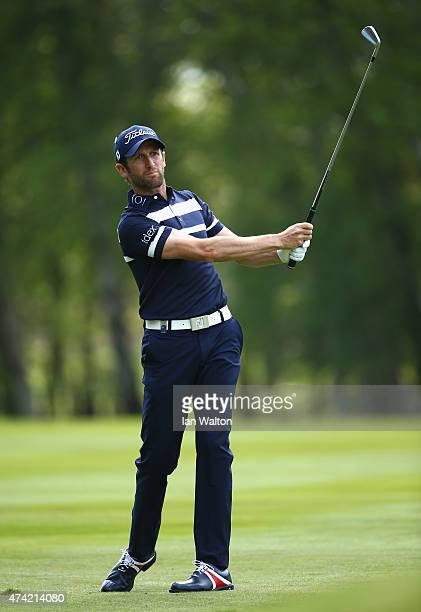 Gregory Bourdy of France hits his 2nd shot on the 9th hole during day 1 of the BMW PGA Championship at Wentworth on May 21 2015 in Virginia Water...