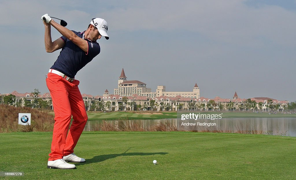 Gregory Bourdy of France hits his tee-shot on the ninth hole during the final round of the BMW Masters at Lake Malaren Golf Club on October 27, 2013 in Shanghai, China.
