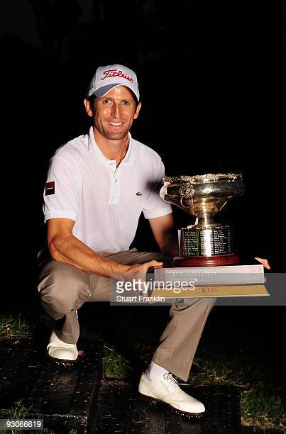 Gregory Bourdy of France holds the winners trophy after winning the UBS Hong Kong Open at the Hong Kong Golf Club on November 15 2009 in Fanling Hong...