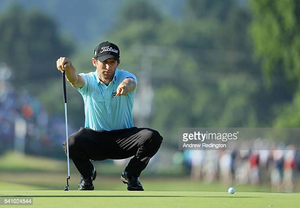 Gregory Bourdy of France lines up a putt on the third green during the continuation of the second round of the US Open at Oakmont Country Club on...