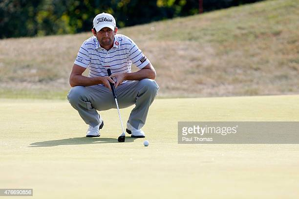 Gregory Bourdy of France linesup a putt during the Lyoness Open day one at the Diamond Country Club on June 11 2015 in Atzenbrugg Austria