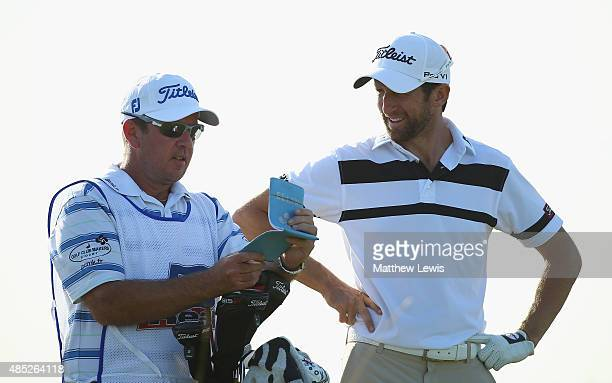 Gregory Bourdy of France looks on with his caddie during a practice round ahead of the DD Real Czech Masters at Albatross Golf Resort on August 26...