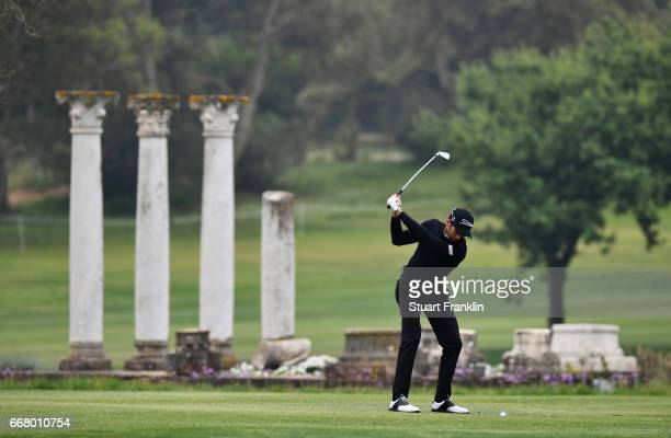 Gregory Bourdy of France plays a shot from the fairway during the first round on day one of the Trophee Hassan II at Royal Golf Dar Es Salam on April...