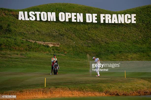 Gregory Bourdy of France plays his shot to the 18th green during Alstom Open de France Day One at Le Golf National on July 2 2015 in Paris France