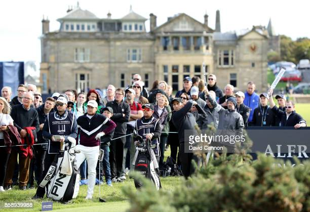 Gregory Bourdy of France plays his tee shot on the second hole watched by his playing partner Tyrrell Hatton of England during the final round of the...