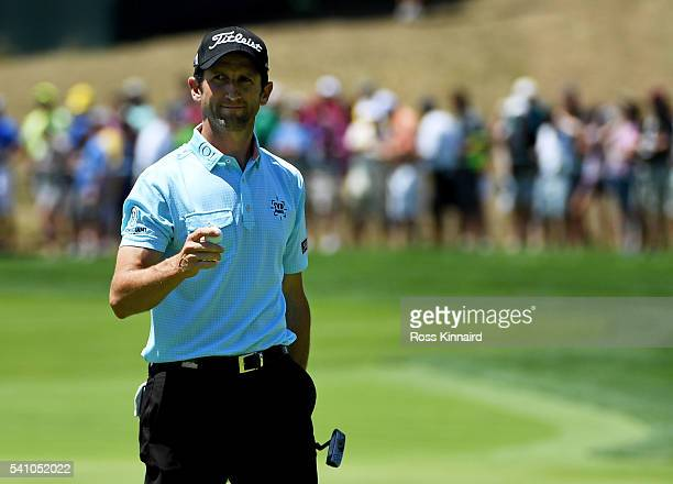 Gregory Bourdy of France reacts after his putt on the 16th hole during the continuation of the second round of the US Open at Oakmont Country Club on...