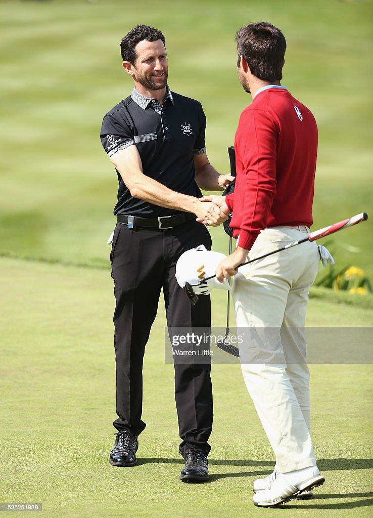 <a gi-track='captionPersonalityLinkClicked' href=/galleries/search?phrase=Gregory+Bourdy&family=editorial&specificpeople=576091 ng-click='$event.stopPropagation()'>Gregory Bourdy</a> of France shakes hands with Jorge Campillo of Spain on the 18th green during day four of the BMW PGA Championship at Wentworth on May 29, 2016 in Virginia Water, England.