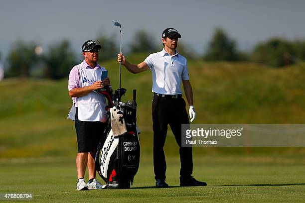 Gregory Bourdy of France takes a club from his bag during the Lyoness Open day two at the Diamond Country Club on June 12 2015 in Atzenbrugg Austria