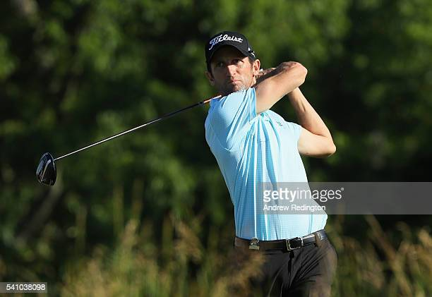 Gregory Bourdy of France watches his tee shot on the fourth hole during the continuation of the second round of the US Open at Oakmont Country Club...