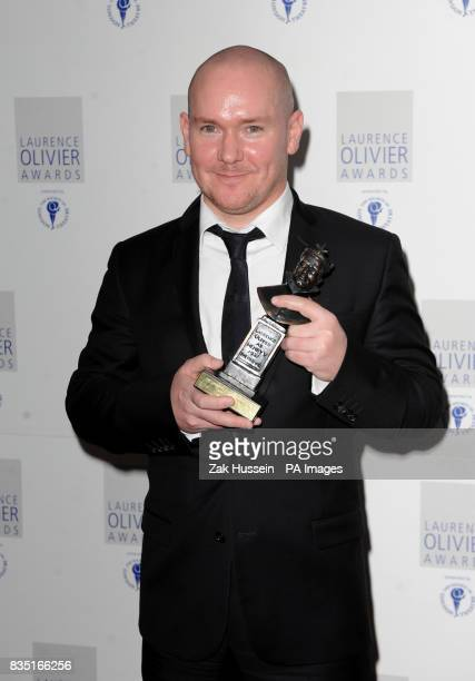 Gregory Burke wins the Best New Play Award during the Laurence Olivier Awards at the Grosvenor Hotel in central London