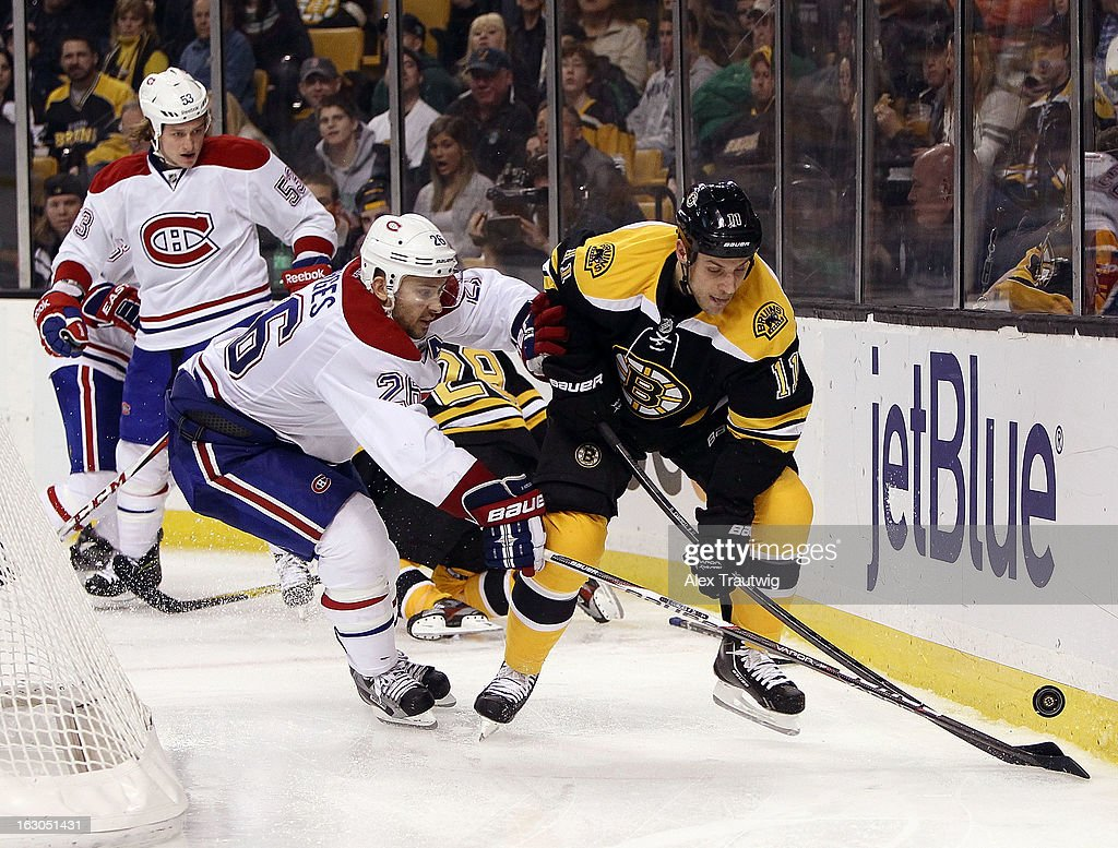 <a gi-track='captionPersonalityLinkClicked' href=/galleries/search?phrase=Gregory+Campbell&family=editorial&specificpeople=640895 ng-click='$event.stopPropagation()'>Gregory Campbell</a> #11 of the Boston Bruins and <a gi-track='captionPersonalityLinkClicked' href=/galleries/search?phrase=Josh+Gorges&family=editorial&specificpeople=550446 ng-click='$event.stopPropagation()'>Josh Gorges</a> #26 of the Montreal Canadiens battle for the puck behind the net during a game at the TD Garden on March 3, 2013 in Boston, Massachusetts.