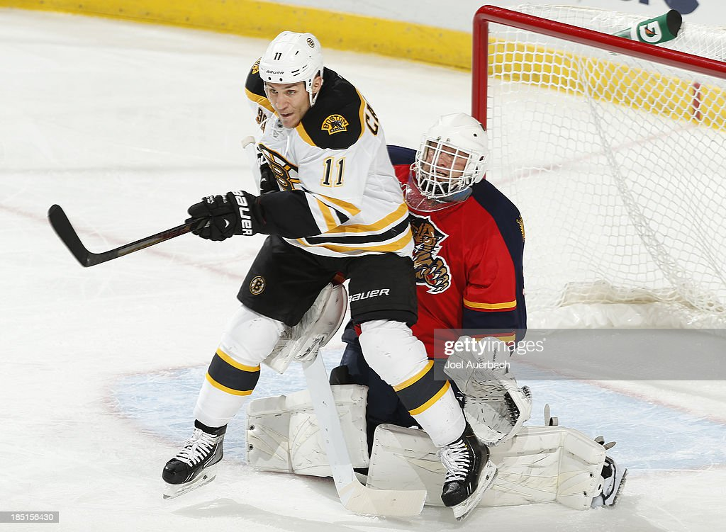 <a gi-track='captionPersonalityLinkClicked' href=/galleries/search?phrase=Gregory+Campbell&family=editorial&specificpeople=640895 ng-click='$event.stopPropagation()'>Gregory Campbell</a> #11 of the Boston Bruins blocks the view of goaltender Tim Thomas #34 of the Florida Panthers during third period action at the BB&T Center on October 17, 2013 in Sunrise, Florida. The Bruins defeated the Panthers 3-2.