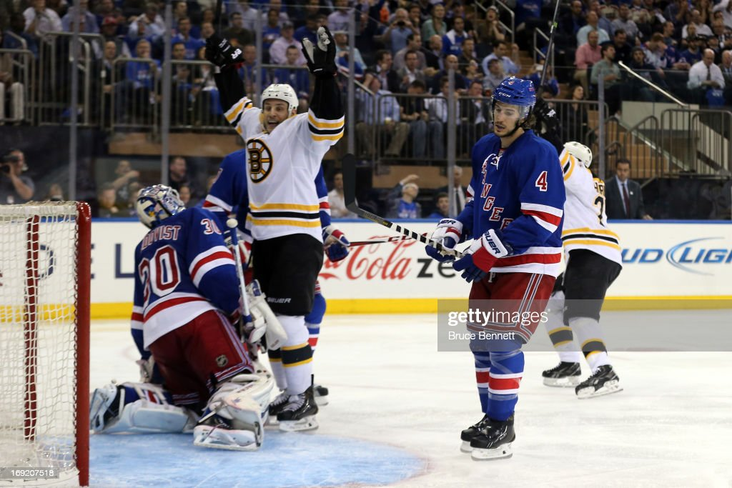 Gregory Campbell of the Boston Bruins celebrates after teammate Johnny Boychuk scored a goal in the third period to tie the score 11 against Henrik...